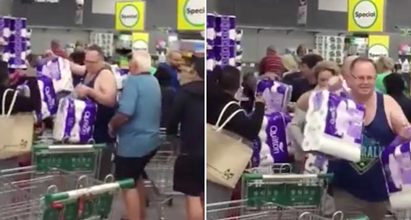 People in a Woolworths at Revesby scramble to buy toilet paper.