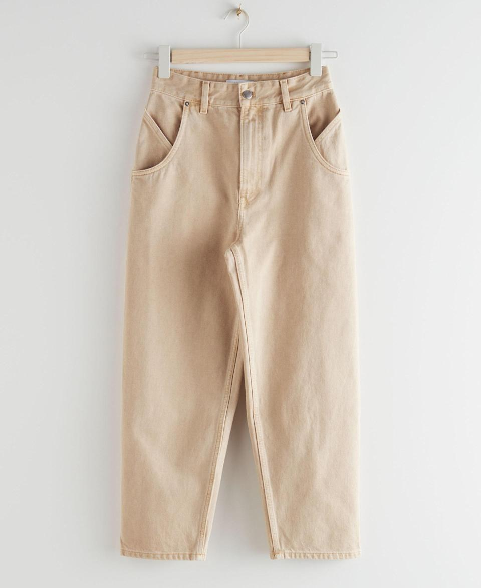 """Step aside, skinny jeans—looser fits like these are taking center stage this fall. $79, & Other Stories. <a href=""""https://www.stories.com/en_usd/clothing/jeans/straight/product.high-rise-carrot-leg-jeans-beige.0887612001.html"""" rel=""""nofollow noopener"""" target=""""_blank"""" data-ylk=""""slk:Get it now!"""" class=""""link rapid-noclick-resp"""">Get it now!</a>"""