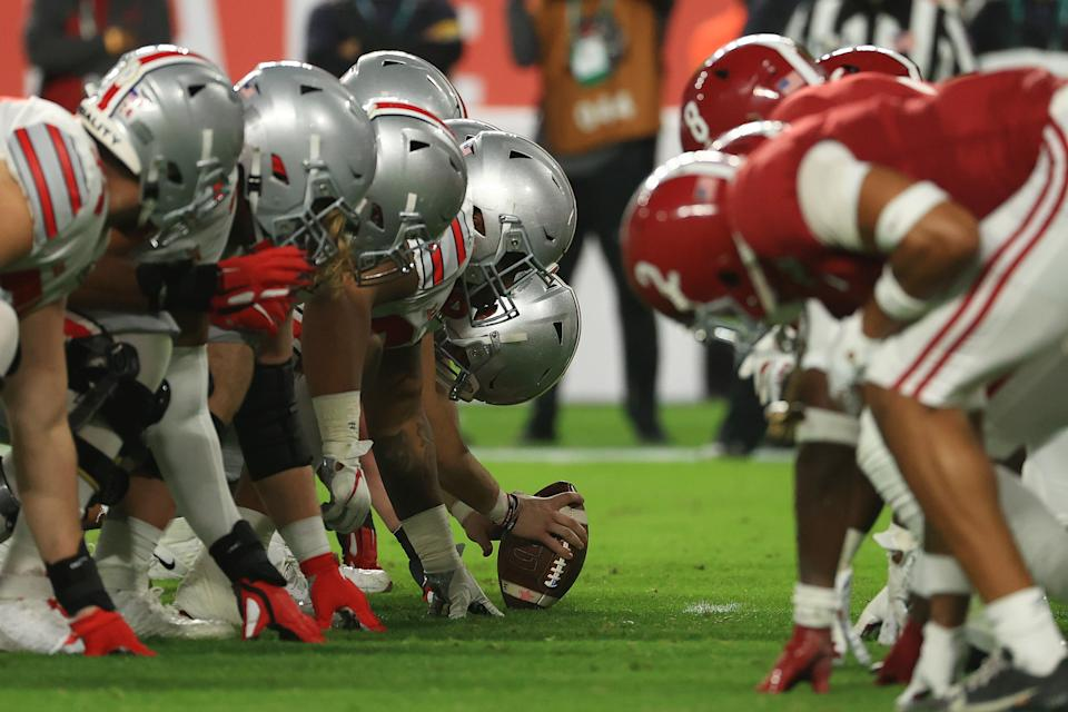 Alabama and Ohio State players line up before a snap during the College Football Playoff title game on Jan. 11. (Mike Ehrmann/Getty Images)