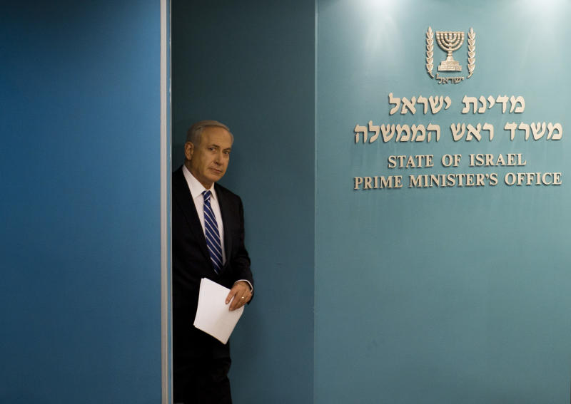 Israeli Prime Minister Benjamin Netanyahu arrives at a conference room at the Prime Minister's office in Jerusalem, Tuesday, Oct. 9, 2012. Netanyahu has ordered new parliamentary elections in early 2013, roughly eight months ahead of schedule. (AP Photo/Bernat Armangue)