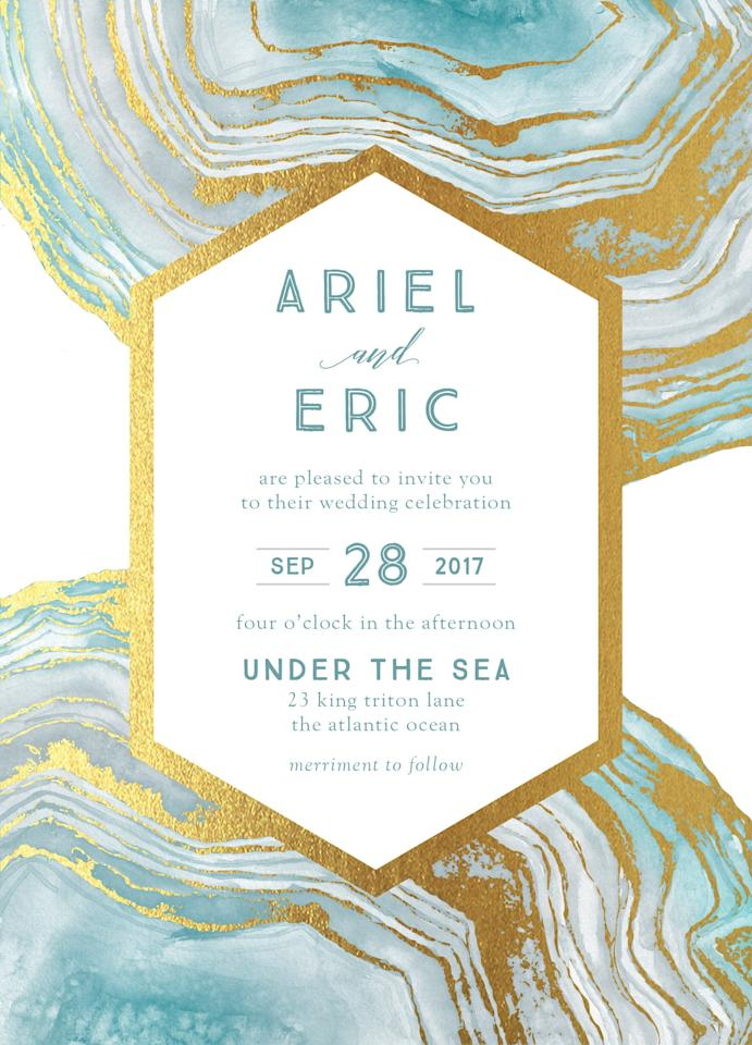 """<p>Ariel wanted to be a """"Part of Your World,"""" but we just want to be a part of this (surely seaside) wedding! The blueish-green hue of <a rel=""""nofollow"""" href=""""https://www.weddingpaperdivas.com/product/22021/signature_foil_wedding_invitations_opulent_lines.html?mbid=synd_yahoostyle&productTest=1"""">this foil-stamped invite</a> would be a great callback to the bride's sea-folk fam.</p>"""