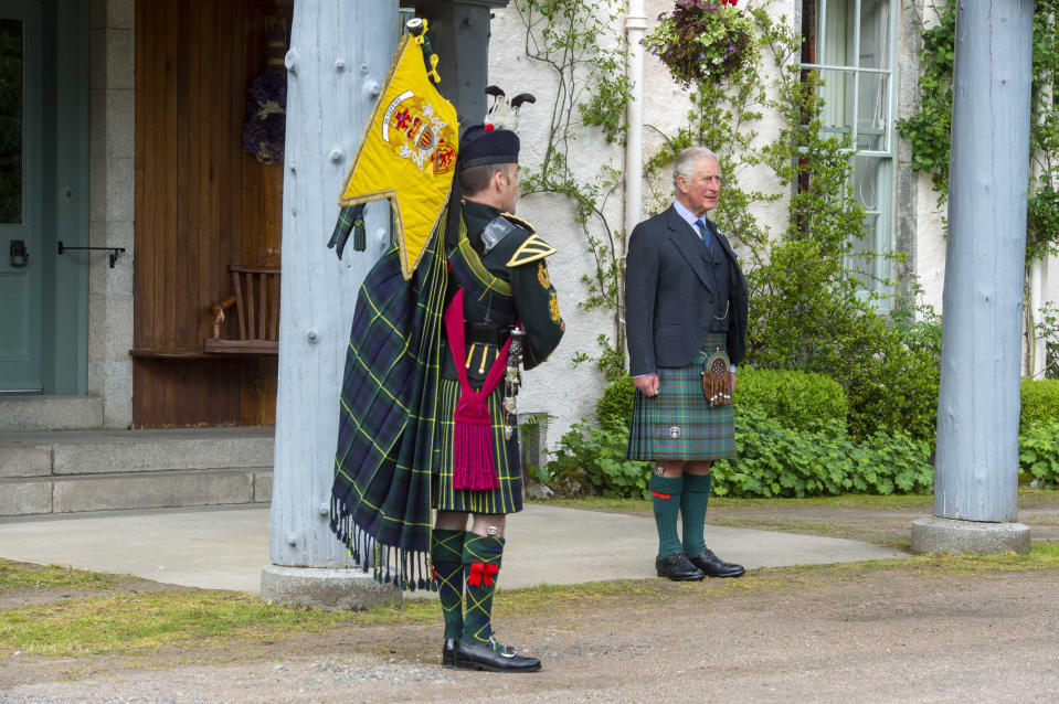 "Handout photo issued by Poppy Scotland of the Prince of Wales, known as the Duke of Rothesay when in Scotland, taking a salute as a piper plays during a St Valery commemoration at his Birkhall residence in Scotland. The ceremony is to commemorate the thousands of Scots who were killed or captured during ""the forgotten Dunkirk"" 80 years ago. Issue date: Friday June 12, 2020. The Second World War battle led to 10,000 mainly Scottish soldiers from the 51st Highland Division being captured at St Valery-en-Caux in France. See PA story ROYAL Pipers. Photo credit should read: Mark Owens/Poppyscotland/PA Wire NOTE TO EDITORS: This handout photo may only be used in for editorial reporting purposes for the contemporaneous illustration of events, things or the people in the image or facts mentioned in the caption. Reuse of the picture may require further permission from the copyright holder."