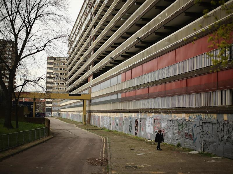 boy walks through the Heygate Estate in the Walworth area on April 24, 2013 in London, England. The Heygate estate in central London was built in 1974 as social housing and housed around 3000 people, but fell into a state of disrepair, gaining a reputation for crime and poverty: Getty