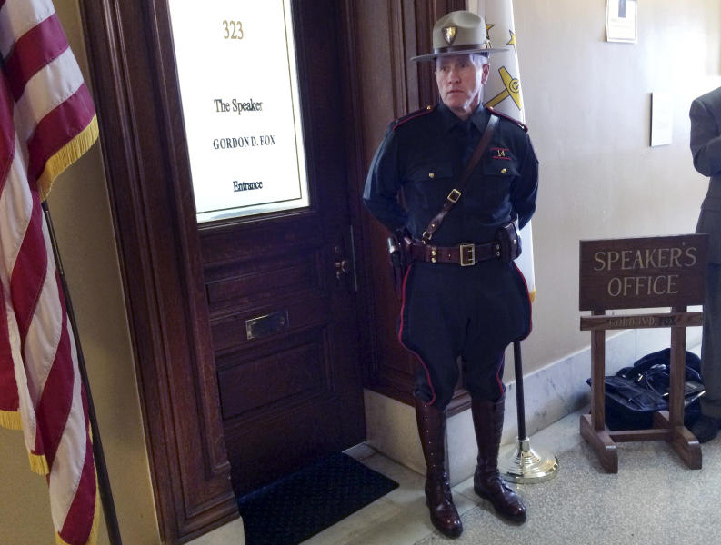 A Rhode Island state trooper stands outside the office of House Speaker Gordon Fox Friday, March 21, 2014 at the Statehouse in Providence, R.I. A U.S. attorney's office spokesman said his office, the FBI, IRS and state police are engaged in a law enforcement action, but would not comment whether the Democratic House speaker was being investigated. (AP Photo/Erika Niedowski)