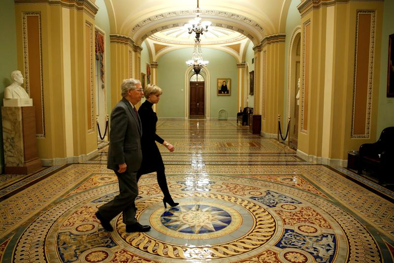 Senate Majority Leader Mitch McConnell (R-Ky.) walks to the Senate floor before a vote to end a government shutdown early Friday. (Joshua Roberts / Reuters)