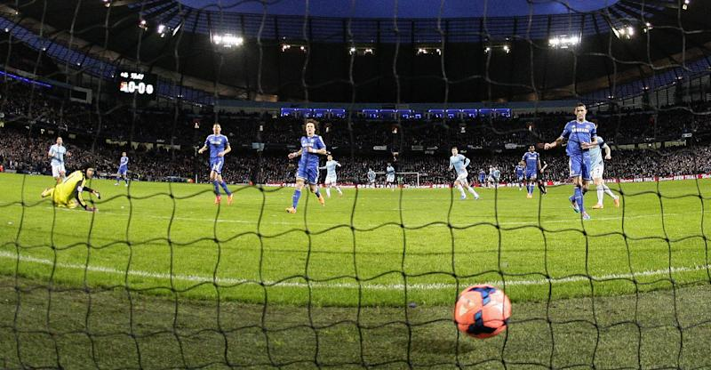 Chelsea's Chelsea's Gary Cahill, right and defenders David Luiz, centre, and Nemanja Matic look at the ball in the back of the net after Manchester City's Steven Jovetic scored the opening goal during their English FA Cup fifth round soccer match at the Etihad Stadium, Manchester, England, Saturday, Feb. 15, 2014. (AP Photo/Jon Super)