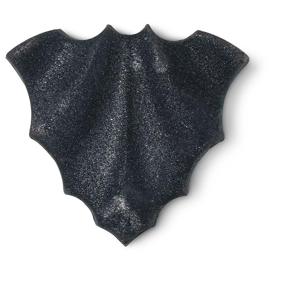 """<p><a class=""""body-btn-link"""" href=""""https://uk.lush.com/products/vegan-bath-products/bat-art"""" target=""""_blank"""">Buy now</a> Lush.com, £4.50</p><p>""""Be spellbound by this bat bath bomb. Full of bath-art worthy surprises, deep glittery waters await with a fresh, herbal scent that lingers.""""</p>"""