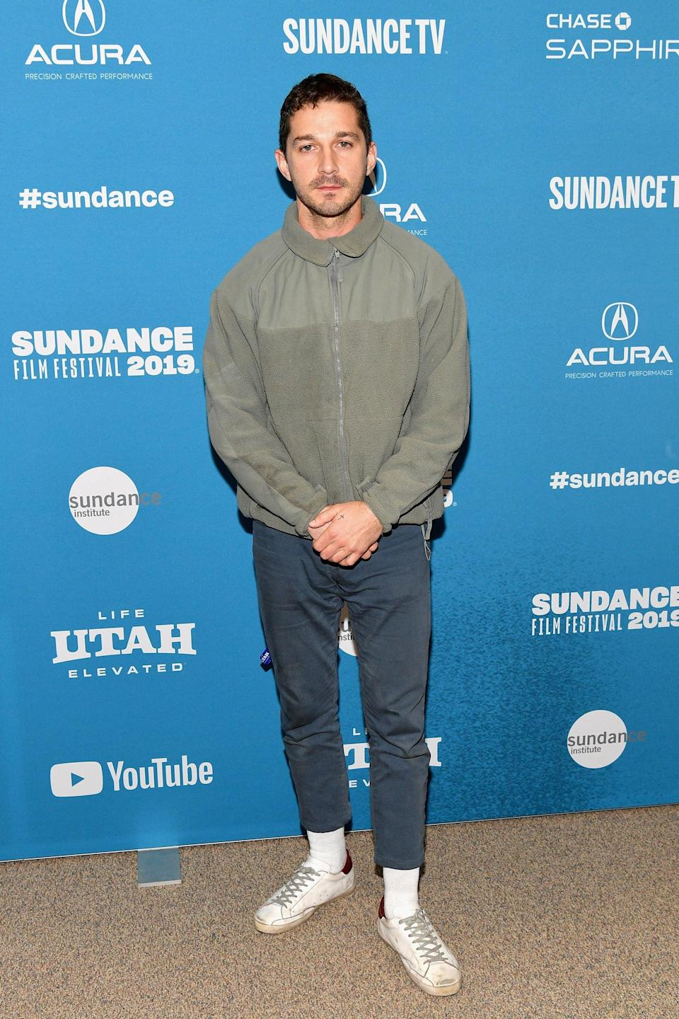 <p>Who says you can't wear sneakers and high socks to a movie premiere? </p>