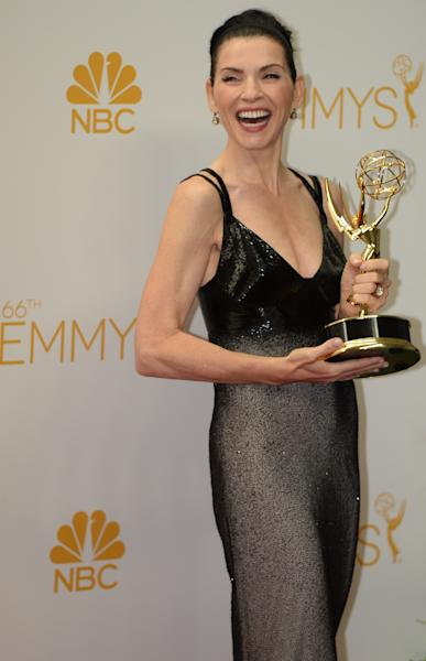 Actress Julianna Margulies poses in the press room after winning the Outstanding Lead Actress in a Drama Series Award for 'The Good Wife' during the 66th Emmy Awards on August 25, 2014 at the Nokia Theatre in Los Angeles (AFP Photo/Mark Ralston)