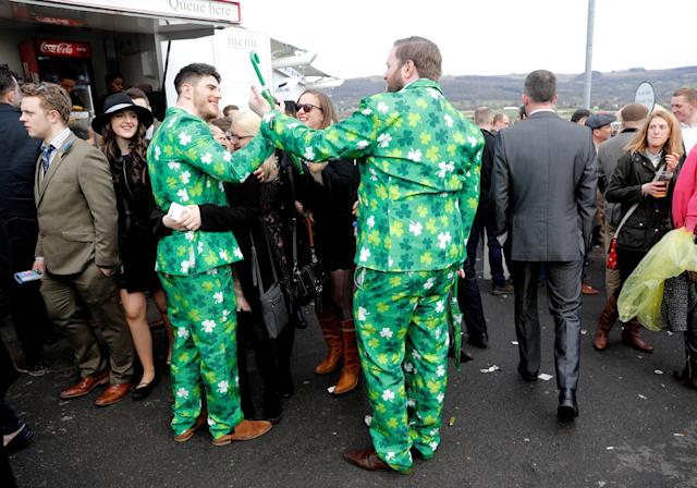 Horse Racing - Cheltenham Festival - Cheltenham Racecourse, Cheltenham, Britain - March 15, 2018 Racegoers wear suits with Shamrock patterns at Cheltenham Festival REUTERS/Darren Staples
