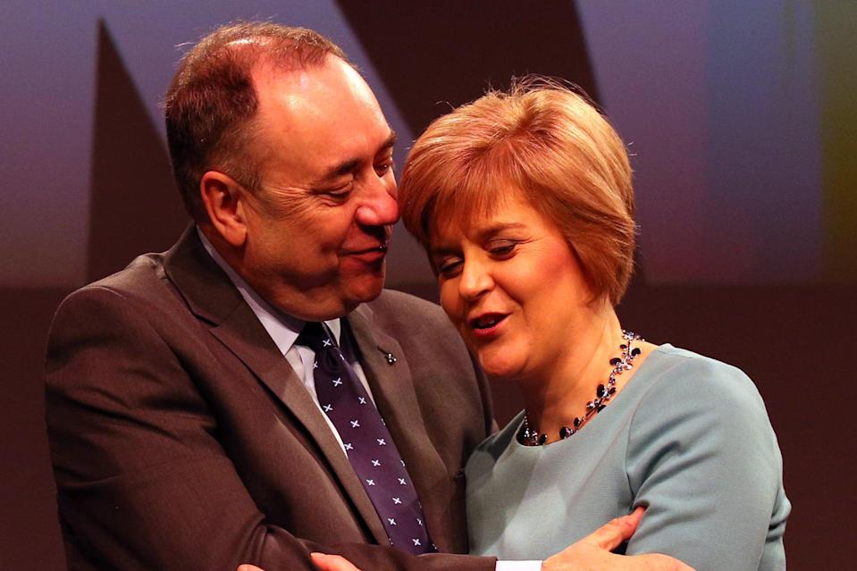 The then First Minister Alex Salmond (left) greeting the then Deputy First Minister Nicola Sturgeon after her speech at the SNP Spring Conference in Aberdeen in 2014PA