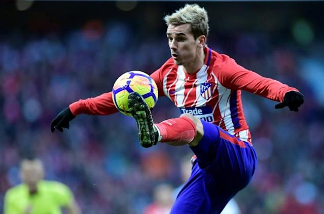Atletico Madrid's forward Antoine Griezmann controls the ball during the Spanish league football match against Real Sociedad December 2, 2017