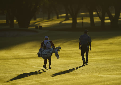 Ryan Palmer was with his caddie down the first fairway during the first round of the Charles Schwab Challenge golf tournament at the Colonial Country Club in Fort Worth, Texas, Thursday, June 11, 2020. (AP Photo/David J. Phillip)