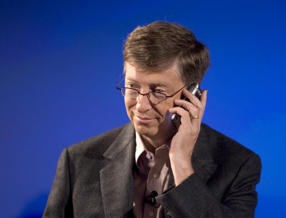 Microsoft Corporation Chairman and Chief Software Architect Bill Gates, holds a new Treo phone during a press conference to announce a strategic alliance to expand the smartphone market with a new line of Treo smartphones from Verizon Wireless. (Photo by Kim Kulish/Corbis via Getty Images)