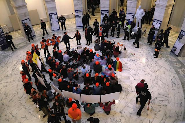 <p>Police arrest immigration activists conducing an act of civil disobediance in the rotunda of the Russell Senate Office Building on Feb. 7, 2018 in Washington D.C. (Photo: John Moore/Getty Images) </p>