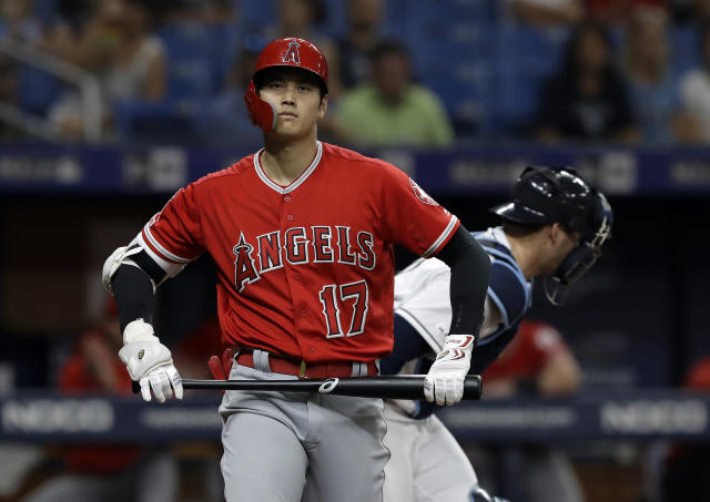 Los Angeles Angels' Shohei Ohtani, of Japan, reacts after drawing a bases-loaded walk from Tampa Bay Rays starting pitcher Blake Snell during the second inning of a baseball game Friday, June 14, 2019, in St. Petersburg, Fla. (AP Photo/Chris O'Meara)