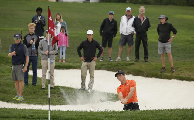 Viktor Hovland, of Norway, hits out of a bunker up to the 17th green of the Pebble Beach Golf Links during the final round of the USGA Amateur Golf Championship against Devon Bling, Sunday, Aug. 19, 2018, in Pebble Beach, Calif. (AP Photo/Eric Risberg)