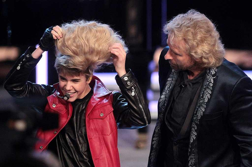 "Also testing out a new hairstyle this week was pop star Justin Bieber. The 17-year-old covered up his signature coif with a bouffant blonde wig while making an appearance on German TV show ""Wetten Das."" We vote you stick to your natural 'do, JBiebs! Johannes Simon/<a href=""http://www.gettyimages.com/"" target=""new"">GettyImages.com</a> - March 19, 2011"