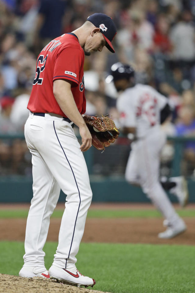 Cleveland Indians relief pitcher Nick Wittgren waits for Boston Red Sox's Jackie Bradley Jr. to run the bases after Bradley hit a solo home run in the 10th inning of a baseball game Tuesday, Aug. 13, 2019, in Cleveland. The Red Sox won 7-6 in 10 innings. (AP Photo/Tony Dejak)