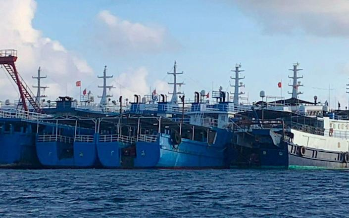 China has the world's largest fishing fleet and it is often accused of illegal activities - AP