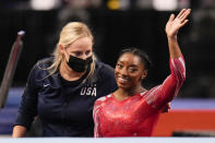 Simone Biles waves after competing in the floor exercise during the women's U.S. Olympic Gymnastics Trials Sunday, June 27, 2021, in St. Louis. (AP Photo/Jeff Roberson)