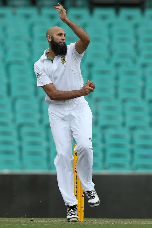 SYDNEY, AUSTRALIA - NOVEMBER 03:  Hashim Amla of South Africa bowls during day two of the International TOur Match between Australia A and South Africa at Sydney Cricket Ground on November 3, 2012 in Sydney, Australia.  (Photo by Chris Hyde/Getty Images)