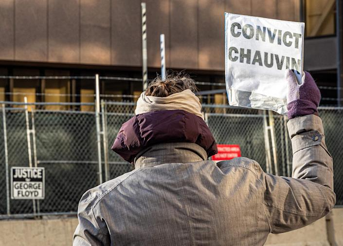 A woman protests outside the Hennepin County Government Center, where the trial of former police officer Derek Chauvin is being held, in Minneapolis on March 31, 2021. (Kerem Yucel / AFP - Getty Images)