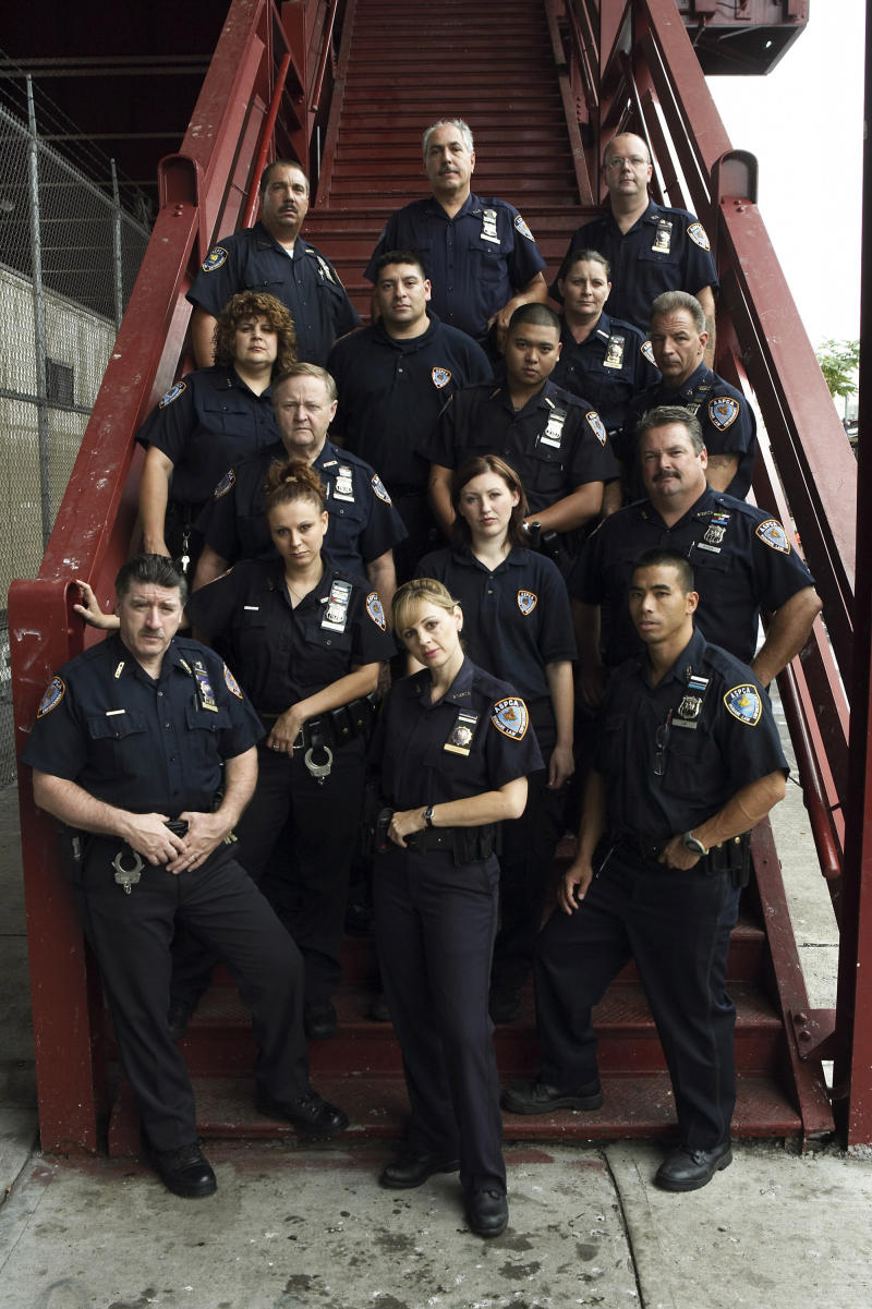"""FILE - This undated file photo provided by Animal Planet shows American Society for the Prevention of Cruelty to Animals agents in the cast of """"Animal Precinct,"""" an Animal Planet TV reality show, posing for a photograph in New York. ASPCA agents wore uniforms, flashed badges, carried guns, traveled in blue-and-white squad cars, and for years starred in """"Animal Precinct,"""" but as of this month, the ASPCA laid off almost all of its 18 law enforcement agents and is now leaving those responsibilities solely to the New York City Police Department. (AP Photo/Animal Planet, Christian Oath, File) MANDATORY CREDIT: ANIMAL PLANET NO SALES"""