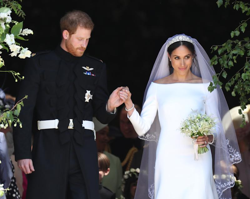 Prince Harry, Duke of Sussex and The Duchess of Sussex leave St George's Chapel, Windsor Castle after their wedding ceremony on May 19, 2018 in Windsor, England.