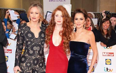 With her former Girls Aloud bandmates, Kimberley Walsh (left) and Nicola Roberts, in 2015 - Credit: getty images