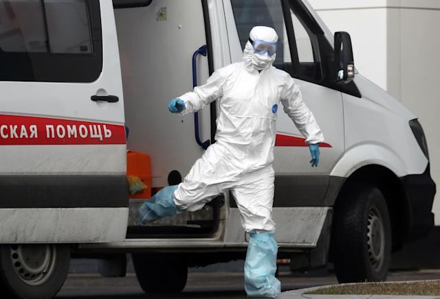 An emergency paramedic is pictured wearing a protective suit at the Novomoskovsky multipurpose medical center in Moscow on 10 March. (Getty Images)