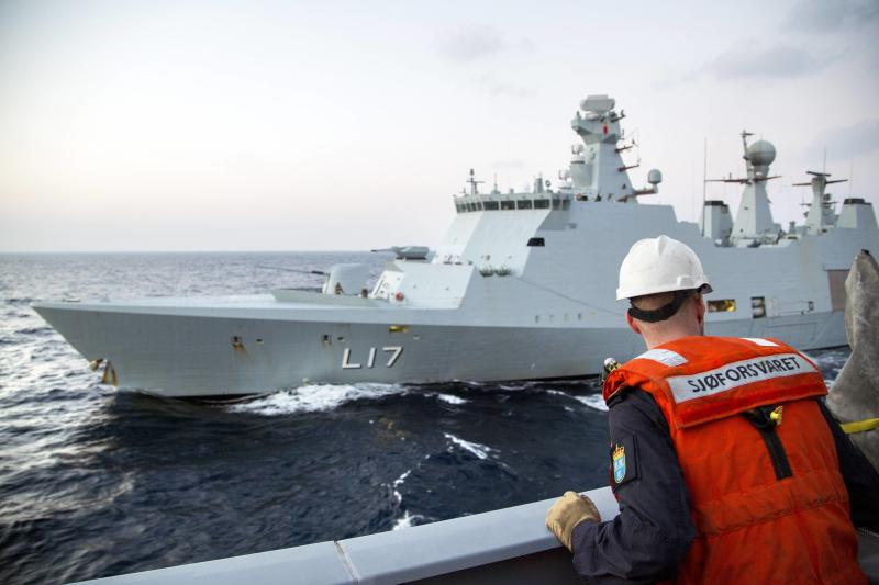 """A Norwegian navy officer looks on as Danish support vessel L17 """"Esbern Snare"""" performs training in the Mediterranean Sea"""