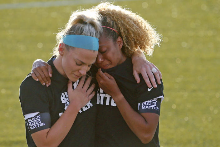 Casey Short and Julie Ertz's embrace during the national anthem on Saturday was undeniably powerful. But why was Short put in that position in the first place? (AP Photo/Rick Bowmer)