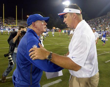 Aug 3, 2014; Canton, OH, USA; New York Giants coach Tom Coughlin (left) and Buffalo Bills coach Doug Marrone shake hands after the 2014 Hall of Fame game at Fawcett Stadium. Kirby Lee-USA TODAY Sports