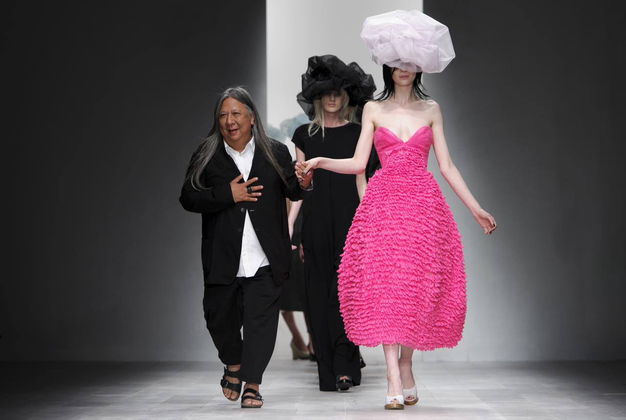 Chinese fashion designer John Rocha at the Spring/Summer 2013 collection during London Fashion Week, Saturday, Sept. 15, 2012. (AP Photo/Jonathan Short)