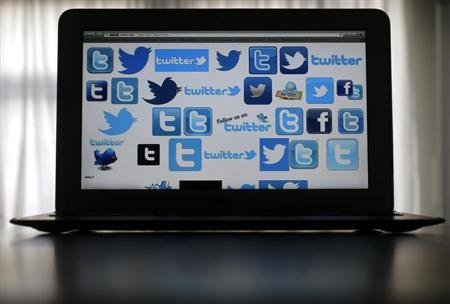 An illustration picture shows Twitter logos on a computer screen in Frankfurt