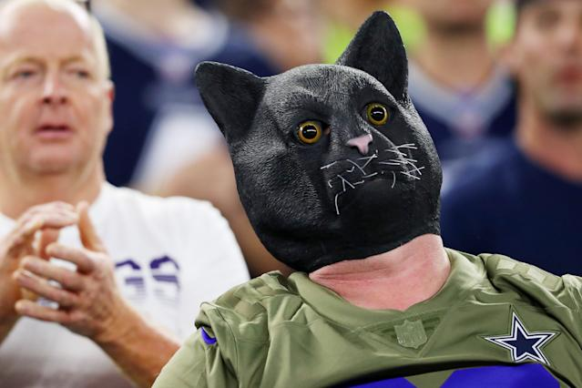A fan wearing a black cat mask attends the game between the Minnesota Vikings and the Dallas Cowboys at AT&T Stadium on November 10, 2019 in Arlington, Texas. (Photo by Tom Pennington/Getty Images)