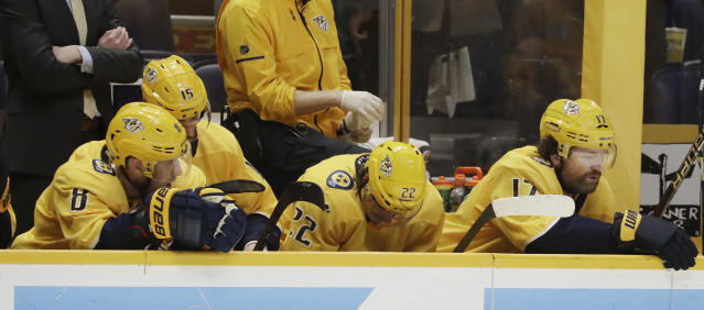 Nashville Predators' Kyle Turris (8); Craig Smith (15); Kevin Fiala (22), of Switzerland; and Scott Hartnell (17) sit on the bench during the final moments against the Winnipeg Jets in Game 7 of an NHL hockey second-round playoff series Thursday, May 10, 2018, in Nashville, Tenn. The Jets won 5-1, knocking the Predators out of the playoffs. (AP Photo/Mark Humphrey)