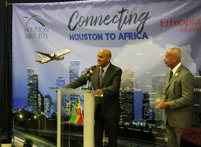 Houston Aviation Director Mario Diaz listens attentively as Ethiopian Airlines Group CEO Tewolde GebreMariam shares his remarks.