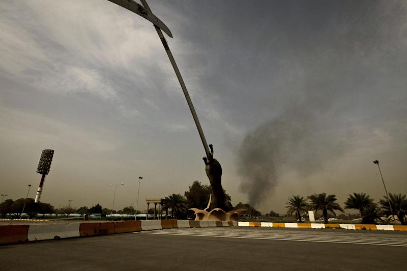 Black smoke from a car bomb attack is seen from the the Crossed Words monument in Baghad, Iraq Thursday, March, 14, 2013. A string of explosions tore through central Baghdad within minutes of each other on Thursday, followed by what appeared to be a coordinated assault by gunmen who battled security forces in the Iraqi capital, according to officials. Authorities say several people have been killed. (AP Photo/Maya Alleruzzo)