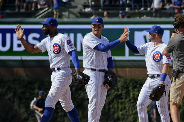 Chicago Cubs right fielder Jason Heyward, left, first baseman Anthony Rizzo, center, and center fielder Ian Happ celebrate at the end of a baseball game against the San Francisco Giants, Thursday, Aug. 22, 2019, in Chicago. (AP Photo/Matt Marton)