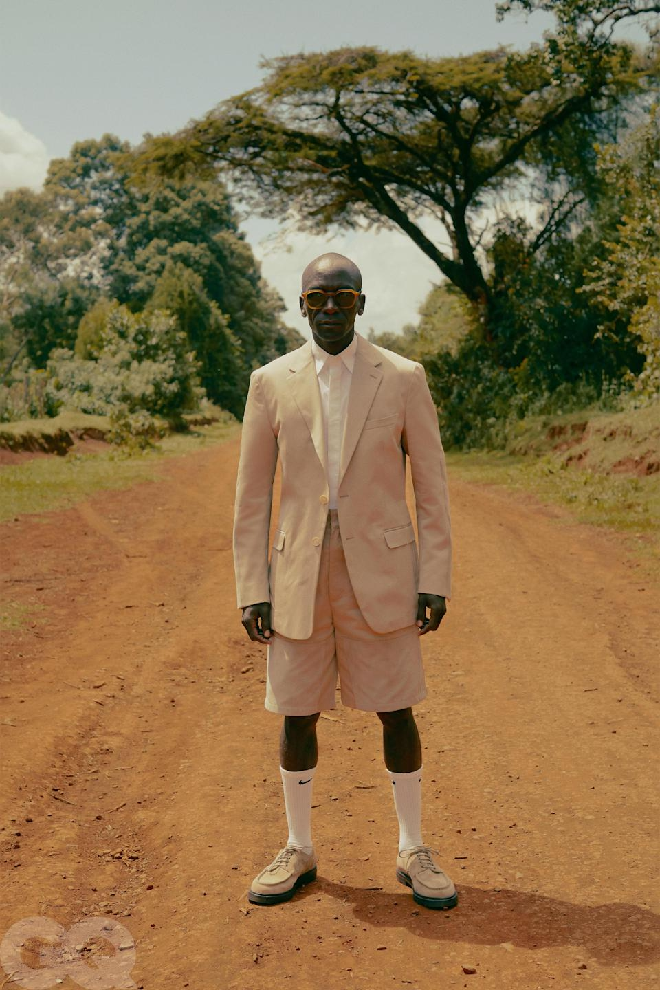 "<h1 class=""title"">eliud-kipchoge-gq-april-2020-lede.jpg</h1><cite class=""credit"">Shirt, $630, and shorts, $890, by Fendi Men's / Shoes, $795, by Manolo Blahnik / Socks, $22 (for six pairs), by Nike / Sunglasses, $415, by Barton Perreira</cite>"