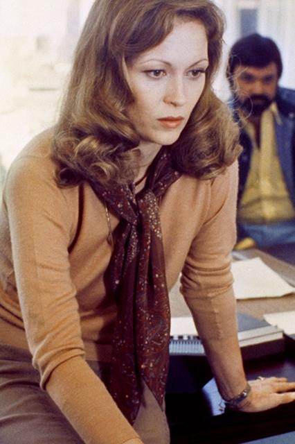 """<h2><em>Network (1976)</em></h2><br>In the classic 1976 satire, Faye Dunaway plays Diana Christensen, a hard-ass network programming executive who cares only about ratings, dammit — well, that and putting together immaculately coordinated earth-toned business-babe outfits. <span class=""""copyright"""">Photo: Courtesy of Warner Bros.</span>"""