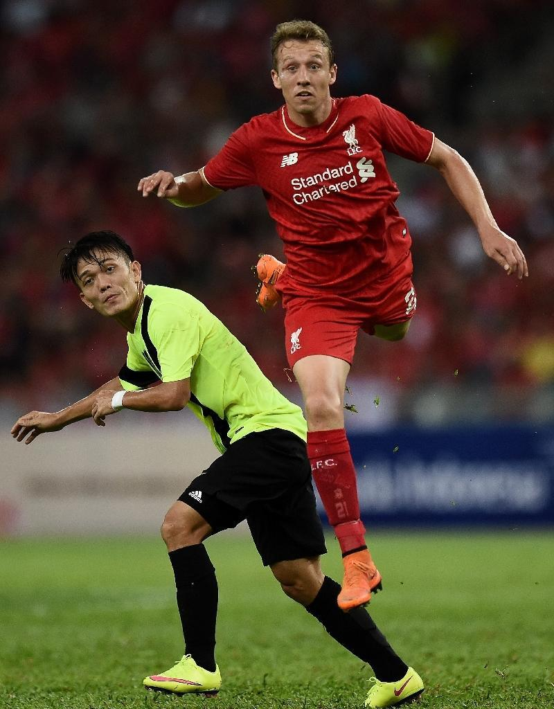 Liverpool's Lucas Leiva (R) fights for the ball with a Malaysian player during a friendly match in Kuala Lumpur, on July 24, 2015 (AFP Photo/Manan Vatsyayana)