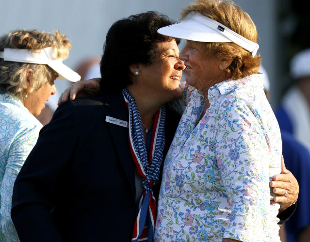 Nancy Lopez, left, greets JoAnne Carner during the first round of the inaugural U.S. Senior Women's Open golf tournament in Wheaton, Ill., Thursday, July 12, 2018. (Daniel White/Daily Herald via AP)