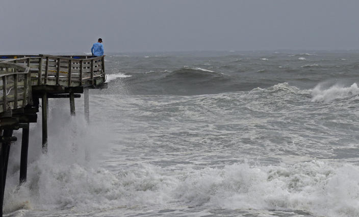 <p>An onlooker checks out the heavy surf at the Avalon Fishing Pier in Kill Devil Hills, N.C., Thursday, Sept. 13, 2018 as Hurricane Florence approaches the east coast. (Photo: Gerry Broome/AP) </p>
