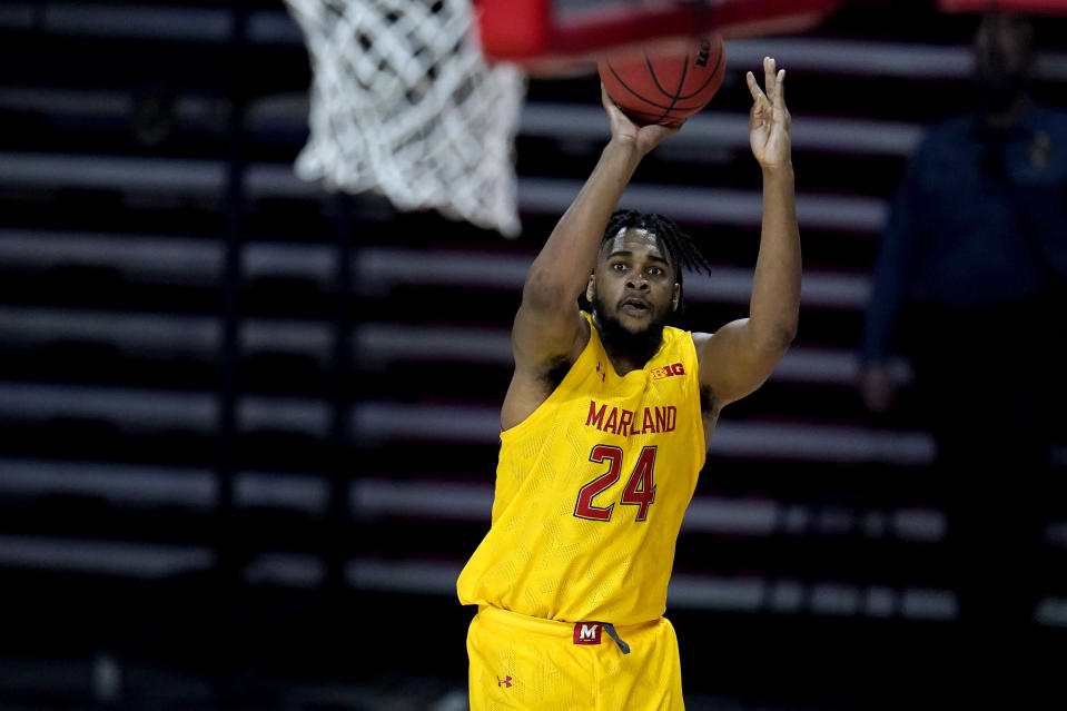 Maryland forward Donta Scott (24) shoots against Michigan State during the second half of an NCAA college basketball game, Sunday, Feb. 28, 2021, in College Park, Md. Maryland won 73-55. (AP Photo/Julio Cortez)