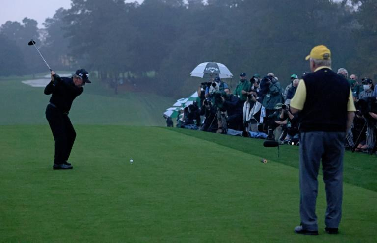 Gary Player prepares to hit a ceremonial tee shot while fellow honorary starter Jack Nicklaus watches as the 84th Masters began Thursday at Augusta National