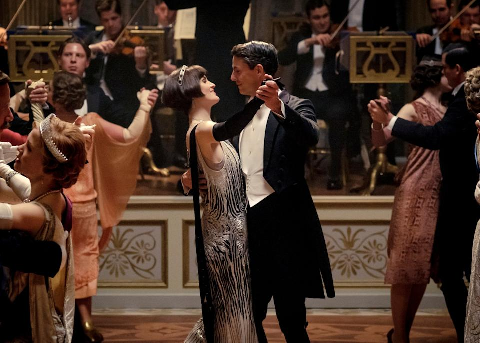 Michelle Dockery as Lady Mary Talbot, centre left, and Matthew Goode as Henry Talbot in a scene from the film: AP