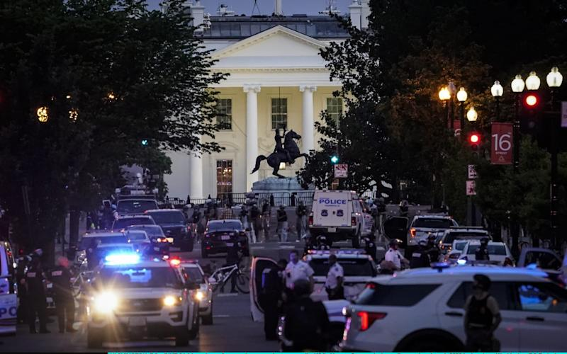 A large law enforcement response is seen near the White House after a protest was dispersed - Getty